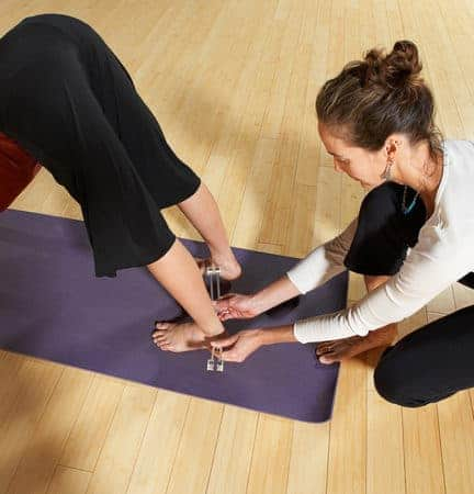 Apply tools to ankles during yoga