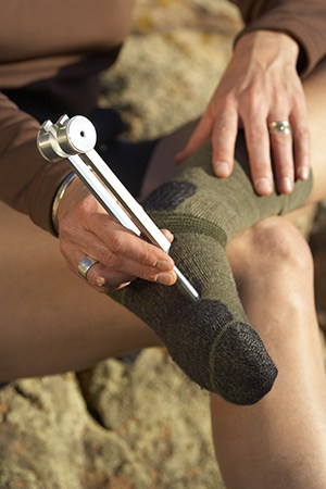 Use tuning forks on the arch of the foot while hiking